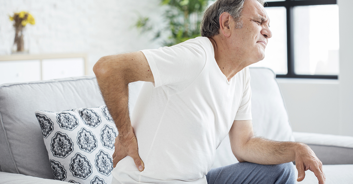 Old man with back pain; blog: never ignore back spasms